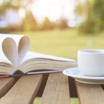Coffee cup and book on the table in the morning